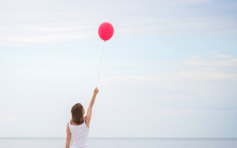 What Mel Did - woman beach with red balloon