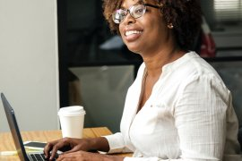 What Mel Did - black woman and laptop